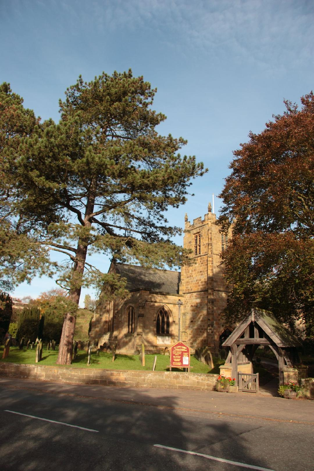 Photograph of All Saints Parish Church and the lych gate/>                                 <div id=